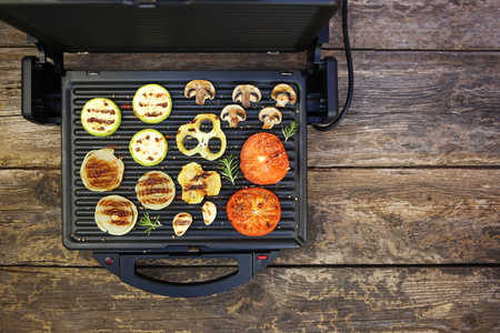 Grilled vegetables on old wooden background. Top view. Flat lay. Banco de Imagens