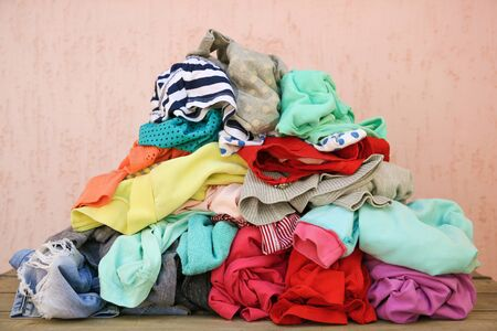 Pile of carelessly scattered clothes. Banco de Imagens