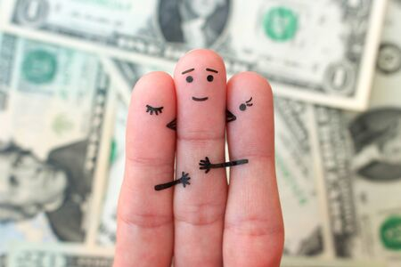 Fingers art. Concept of girls kisses boy on cheek on background of money.