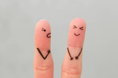 Fingers art of family during quarrel. Concept of wife shouts on husband, man laughs.