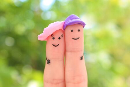 Fingers art of happy couple on vacation. Banco de Imagens - 131144867