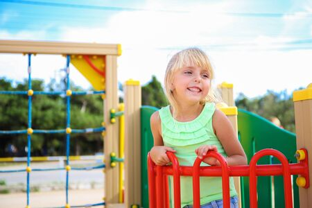 Happy girl on the playground. Banco de Imagens - 131144967