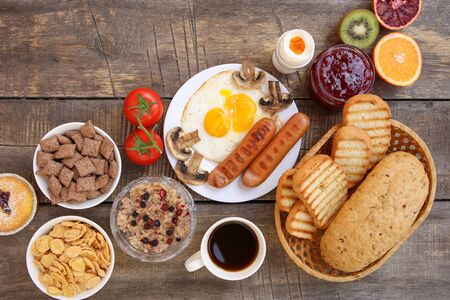 Healthy food on old wooden background. Breakfast. Top view. Flat lay. Banco de Imagens - 131144982