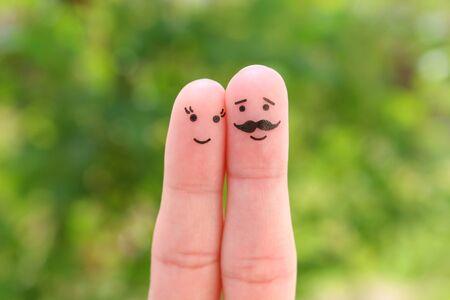 Fingers art of happy couple. Man and woman hug.