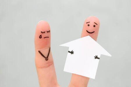 Finger art of family during quarrel. Concept of man and woman divide house after divorce. Banco de Imagens - 131144990