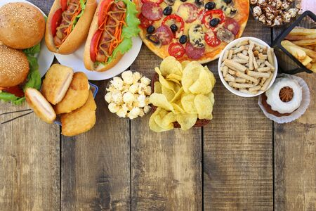 Fast food on old wooden background. Concept of junk eating. Top view. Flat lay. Banco de Imagens - 131145040