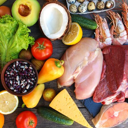 Healthy food on old wooden background. Concept of proper nutrition. Top view. Flat lay.