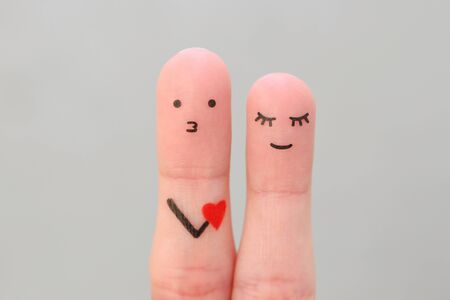 Fingers art of happy couple. Concept of man confessing his love to woman. Banco de Imagens - 131145049