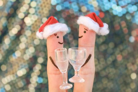 Fingers art of Happy couple in New Year hats.