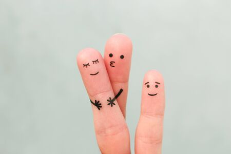 Fingers art of happy family. Concept of couple kissing, child is happy.