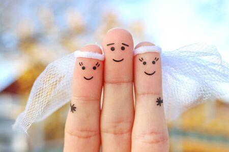 Arte de dedos de gente feliz. Matrimonio plural.