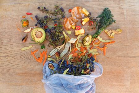 Domestic waste for compost from fruits and vegetables in the garbage bag on the table. Top view.