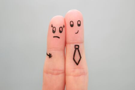 Fingers art of couple. Concept of man harassing woman at work.