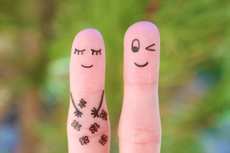 Fingers art of happy couple. Concept of butterfly in stomach.
