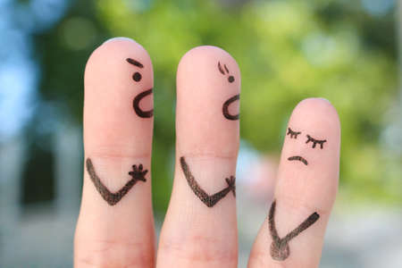 Fingers art of family during quarrel. Concept of parents scold naughty child.