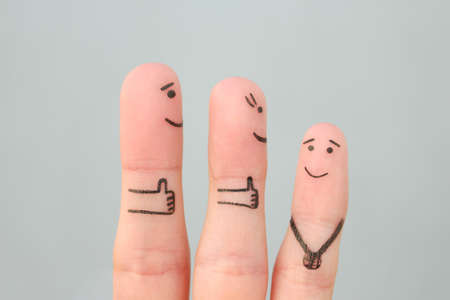 Fingers art of happy family. Concept parents are proud of their child.