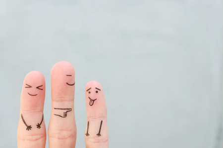 Fingers art of happy family. Concept of child makes face and parents laugh.