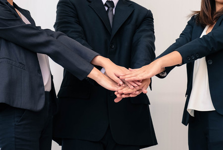 Teamwork, bussiness concept joining hands