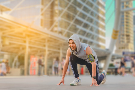 getting out: Sportsman getting ready to run, working out in the city Stock Photo