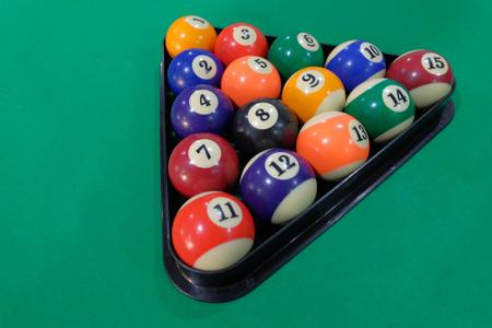 Billiard balls pool in triangle  on green table, game