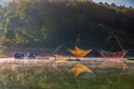 Colorful fishing net in a lake Stock Photo