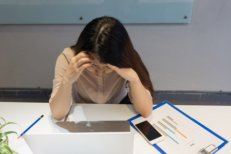 Girl having headache after long working day