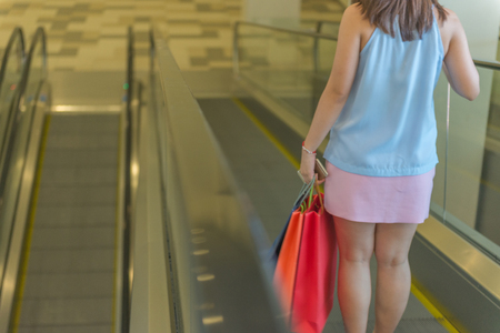 Rear view of woman go shopping in the mall Banque d'images