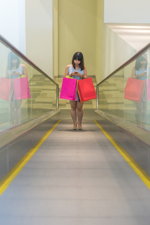 Young Asian girl go shopping in the mall