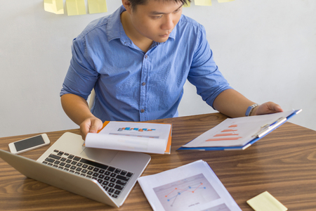Office man checking financial number on report Stock Photo