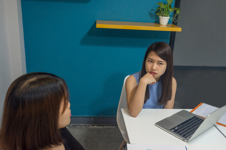 Young office lady discuss with teammate about work