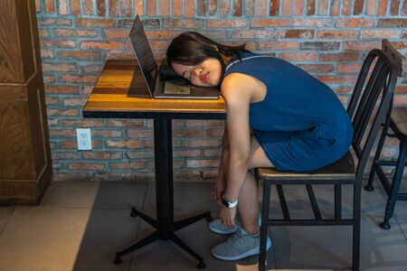 Young restless freelancer fall asleep on her laptop keyboard Stok Fotoğraf