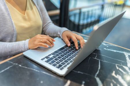 Closeup of married woman hands using laptop