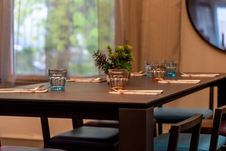 Well-decorated table and glasses prepared for home dining