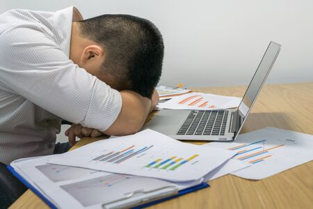 Young tired businessman sleeping in the office