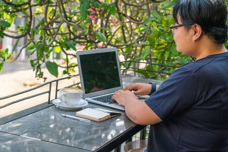 Asian lesbian freelance on laptop at beautiful outdoor coffeeshop Stok Fotoğraf