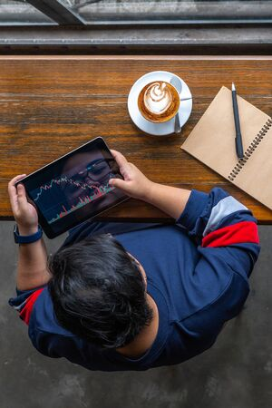 Vertical photo of investor watching stock trading graph on tablet Stok Fotoğraf