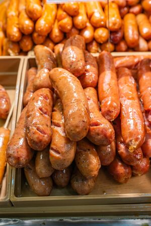 Close up photo of fried sausage at street food market Фото со стока