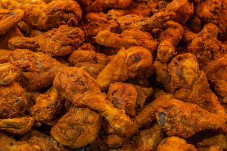 Pile of crispy and tasty fried chicken drumsticks for background