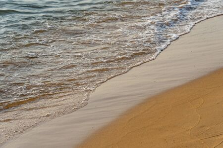 Peaceful and beautiful beach with small waves