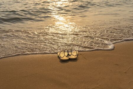 Slipper on the peaceful beach in the sunset