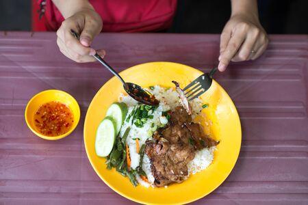 Top view photo of Vietnamese cuisine pork chop broken rice