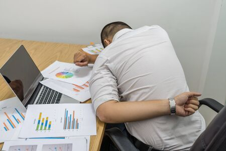 Young man suffering from backache in office