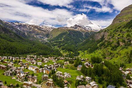 Aerial landscape of Zermatt and Matterhorn peak under cloudy sky Imagens