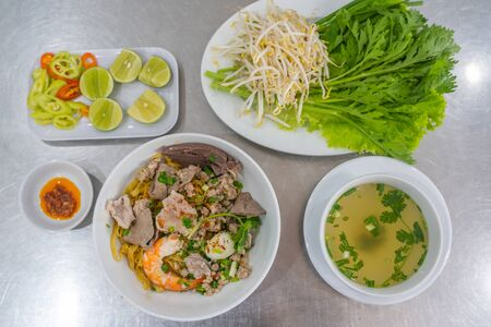 Top view photo of Vietnam rice noodles mixed with meats Reklamní fotografie
