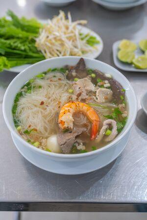 Vertical photo of Vietnamese popular rice noodle soup- Hu Tiu