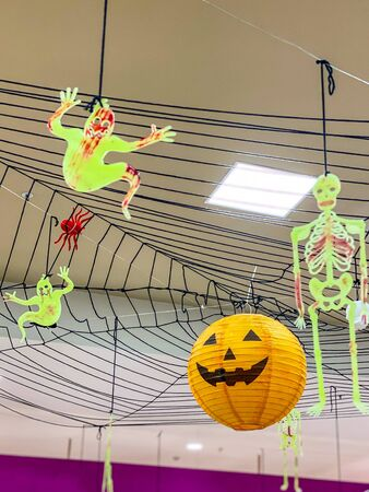 Halloween decoration with spooky jack o lantern and bloody skeleton