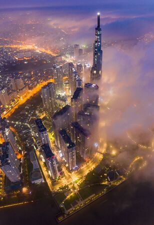 Beautiful aerial night view of cityscape Saigon under dusk sky Stock Photo
