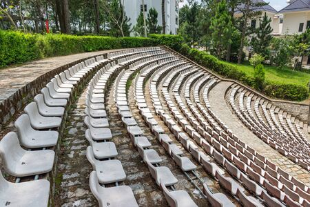 Vacant plastic white chairs at outdoor arena