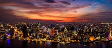 Amazing panorama cityscape and skyline at orange sky sunset evening Stock Photo