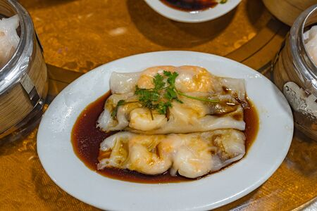 Plate of delicious Chinese dimsum- steamed shrimp rice rolls Stock Photo